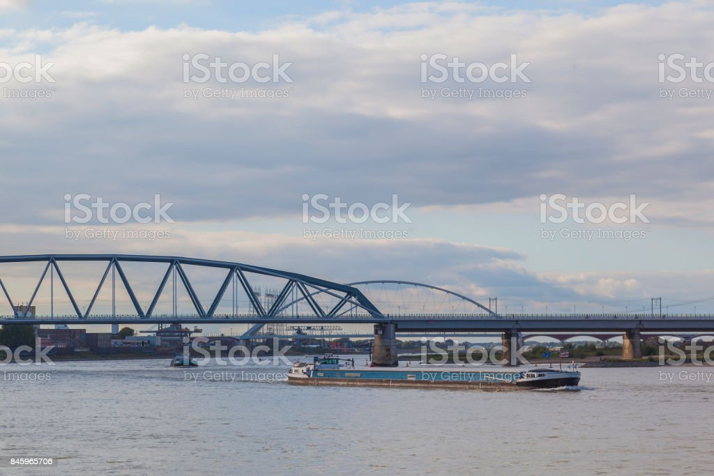 Cargo ship in Waal river at Nijmegen stock photo