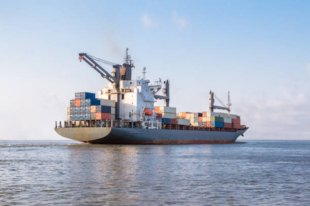 Cargo ship is sailing to sea to transport cargo in containers.Logistics and transportation of International , Freight Transportation, Shipping stock photo