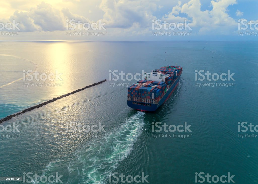Cargo ship leaving port stock photo