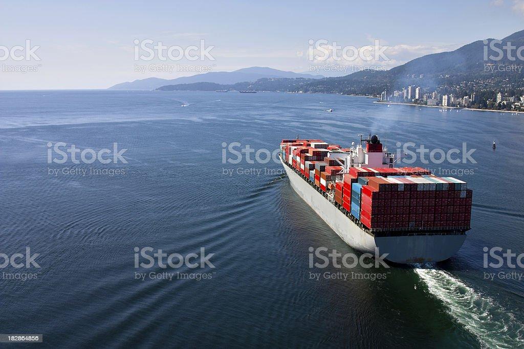 Cargo Ship leaving port royalty-free stock photo