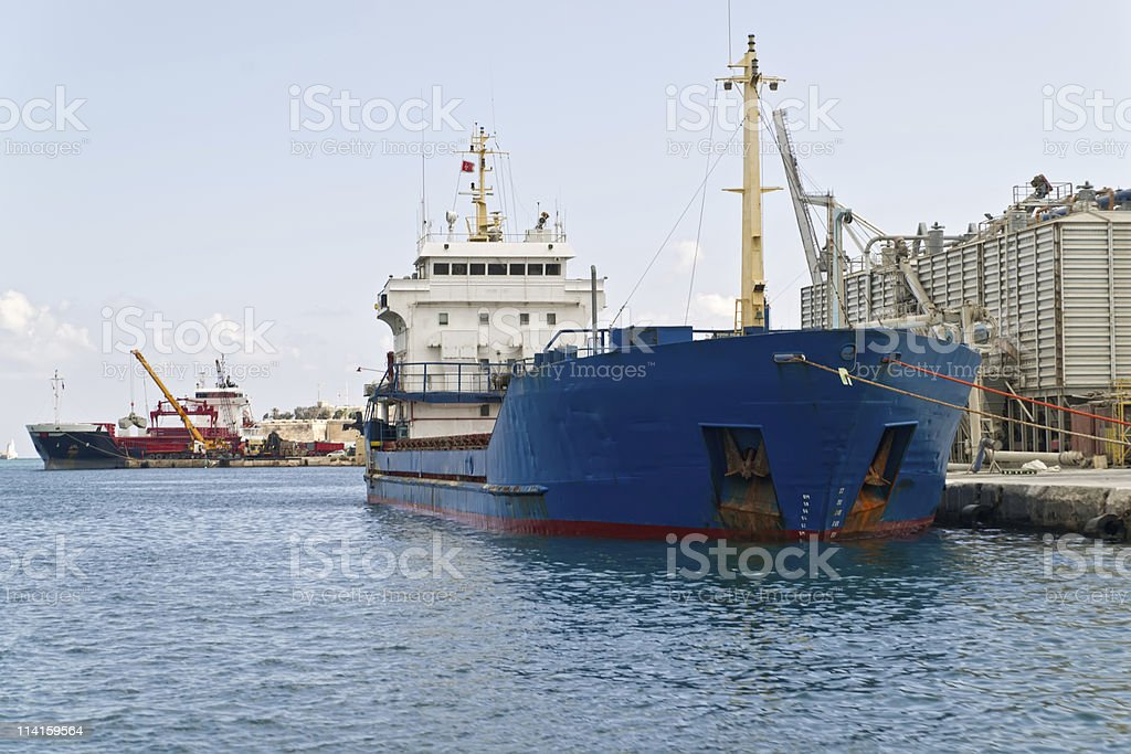 Cargo ship moored in Grand harbour. Malta royalty-free stock photo