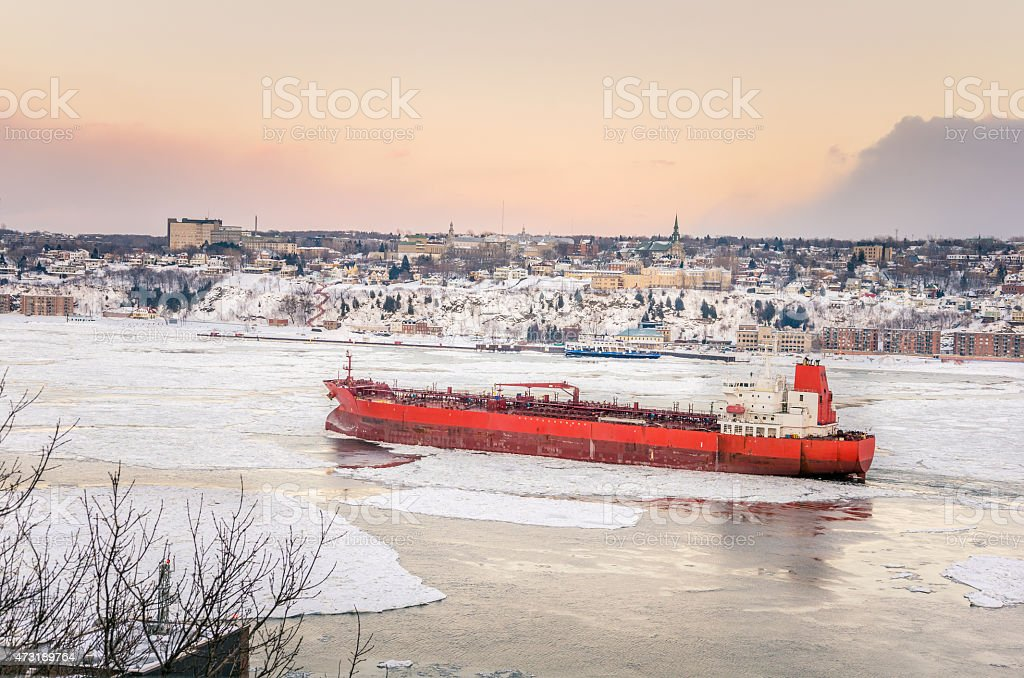 Cargo Ship on Saint Lawrence River in Winter stock photo