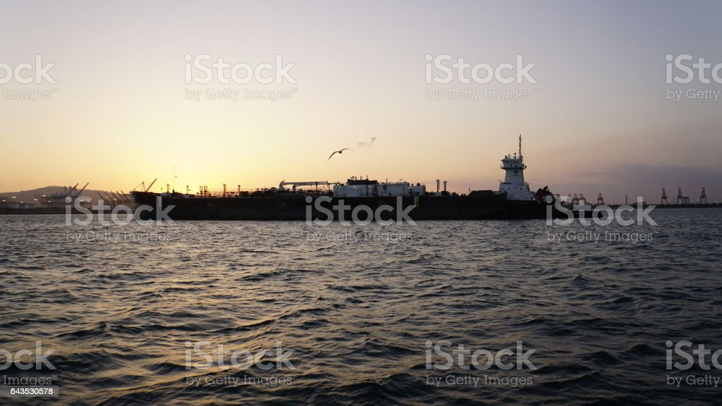 Cargo ship on the way out to sea. stock photo
