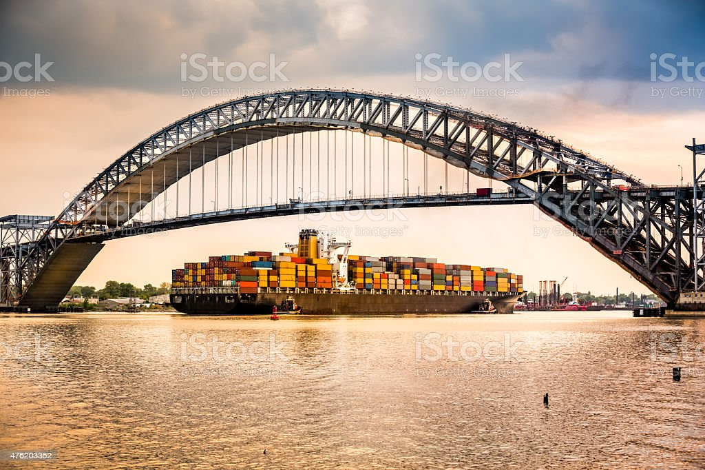 Cargo ship passes under Bayonne Bridge, NJ stock photo