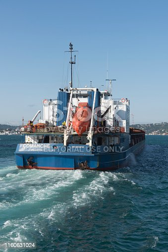 Istanbul, Turkey - Jully 03 2019: A cargo ship tanker travelling through Bosphorus Strait, istanbul, Turkey