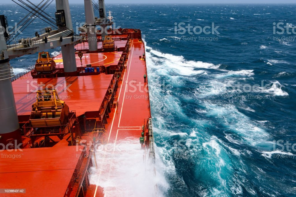 Cargo Ship Rolling In Stormy Indian Ocean Stock Photo