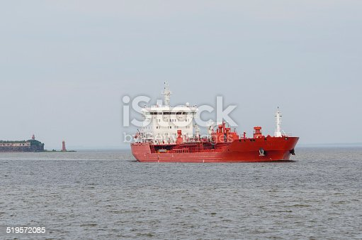 istock Cargo ship sailing in still water. 519572085