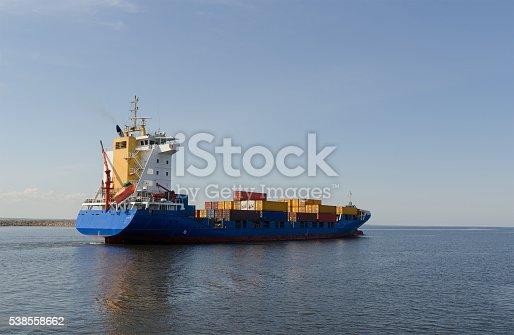 istock Cargo ship sailing in still water 538558662