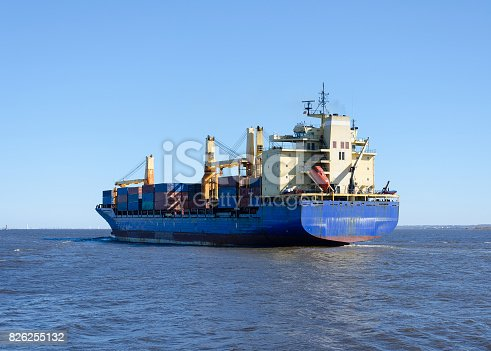 istock Cargo ship sailing in still water 826255132