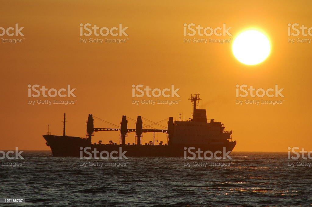 Cargo ship silhouette royalty-free stock photo