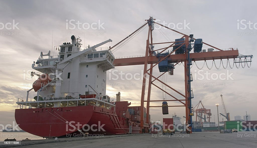 Cargo ship, Trailer and port crane royalty-free stock photo