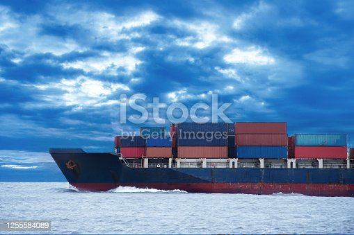 istock Cargo ship travel on the ocean with cloudy sky background 1255584089