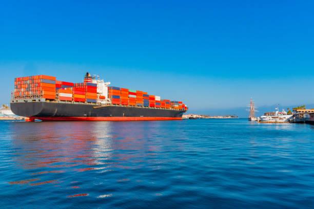 Cargo Ship travels through Los Angeles Port in Long Beach, California (P) stock photo
