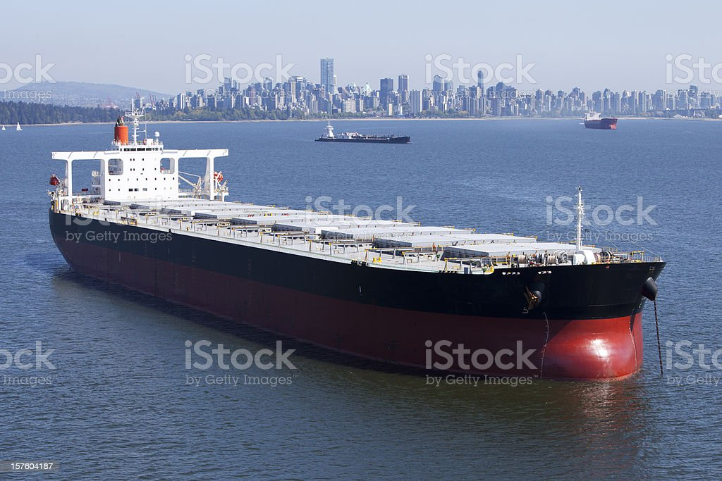Cargo Ship with City Background royalty-free stock photo