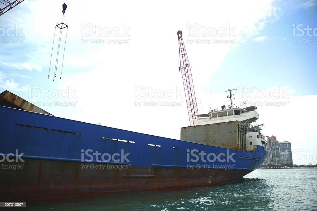 Cargo Ship With Crane In Port Of Miami stock photo