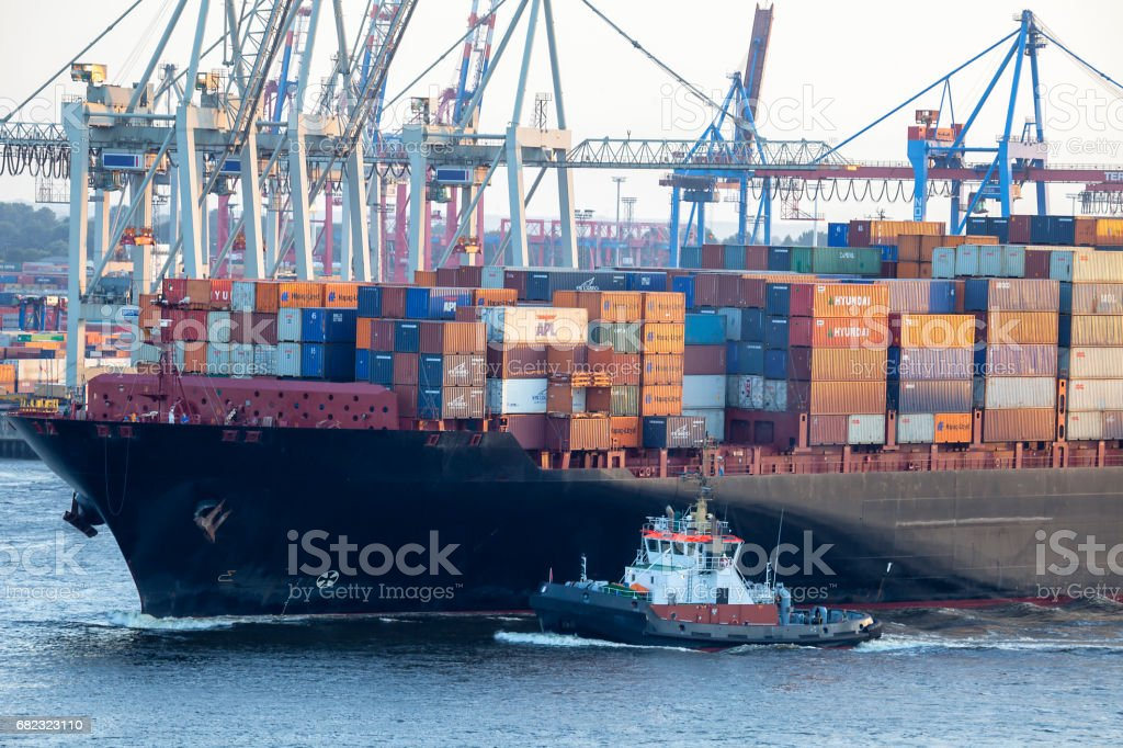 Cargo Shipping Containers Stacked at Harbor Freight Terminal in Hamburg stock photo