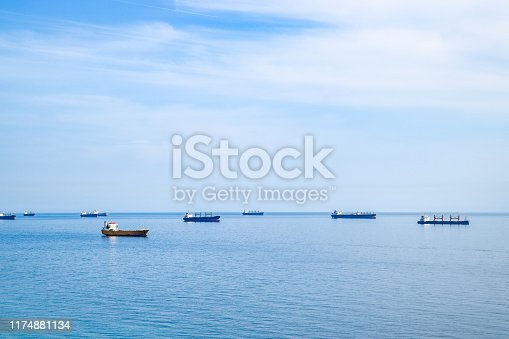 istock Cargo ships and barges at sea, squadron of cargo ships. 1174881134