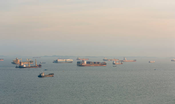 Cargo ships and oil tankers anchored offshore along the Singapore Straight, in Singapore stock photo
