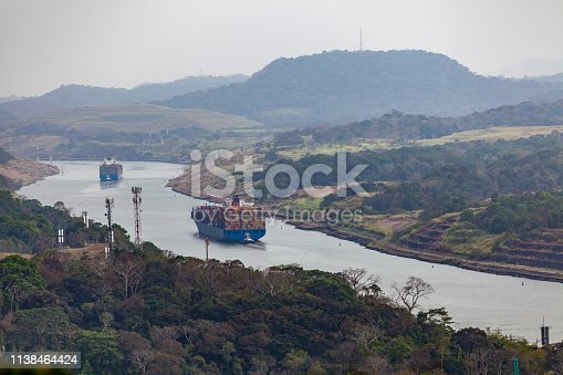 huge cargo ships crossing the panama canal from the caribian to the pacific.