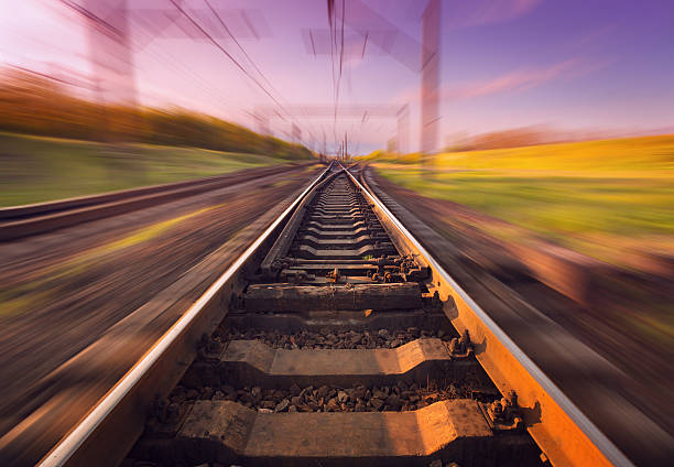 Cargo train platform at sunset. Railroad. Railway station Cargo train platform at sunset with blur effect. Railroad in Ukraine. Railway station. tramway stock pictures, royalty-free photos & images