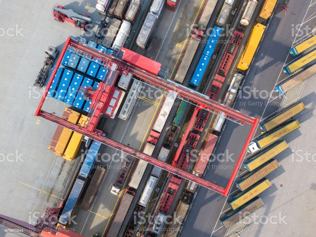 Cargo trains, trucks and a huge crane at freight terminal, Austria stock photo