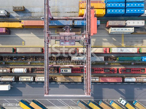 Cargo trains, trucks and a huge crane at freight terminal, Wels, Austria