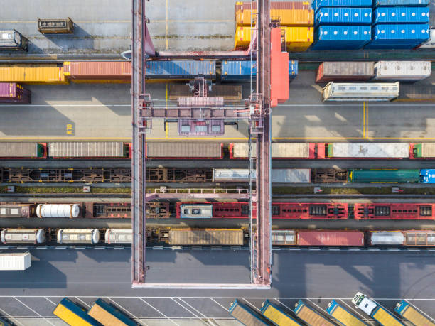 Cargo trains, trucks and a huge crane at freight terminal, Austria stock photo