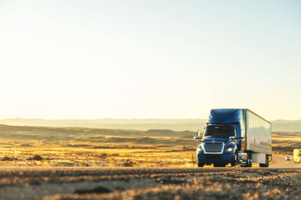 Cargo Transport Long Haul Semi Truck On a Rural Western USA Interstate Highway stock photo