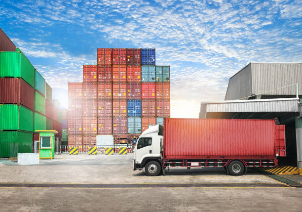 cargo transportation unloading container trucks in warehouse logistics import export background - lorries unloading stock photos and pictures