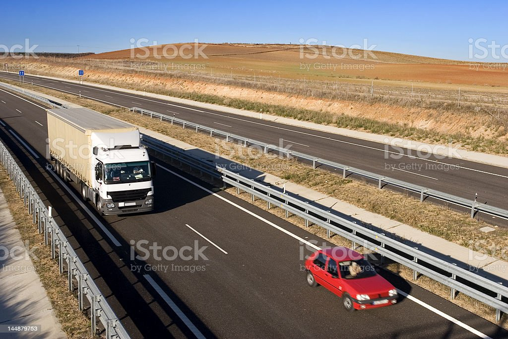 Cargo truck and car on highway royalty-free stock photo