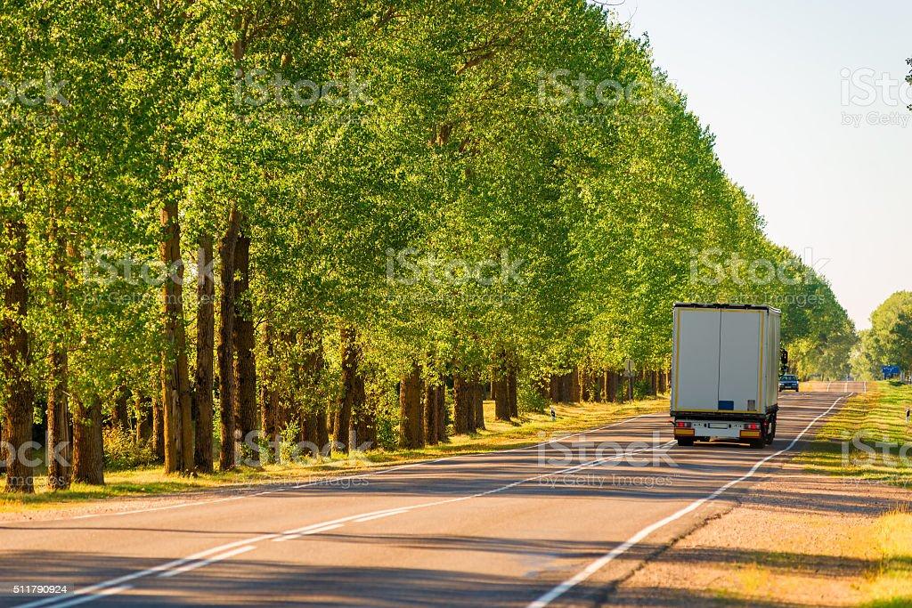 cargo truck driving on suburban highways in summer stock photo