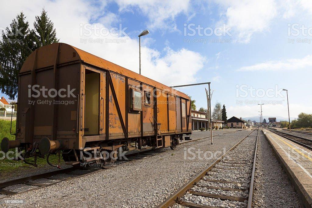 Cargo wagon on a rail road royalty-free stock photo