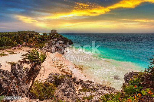 Caribbean beach at the cliff in Tulum at sunset, Mexico