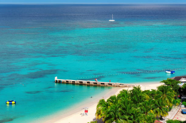 caribbean beach in montego bay, jamaica - jamaica stock photos and pictures