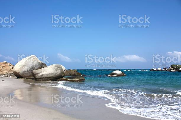 Photo of Caribbean beach with tropical forest. Tayrona National Park. Col