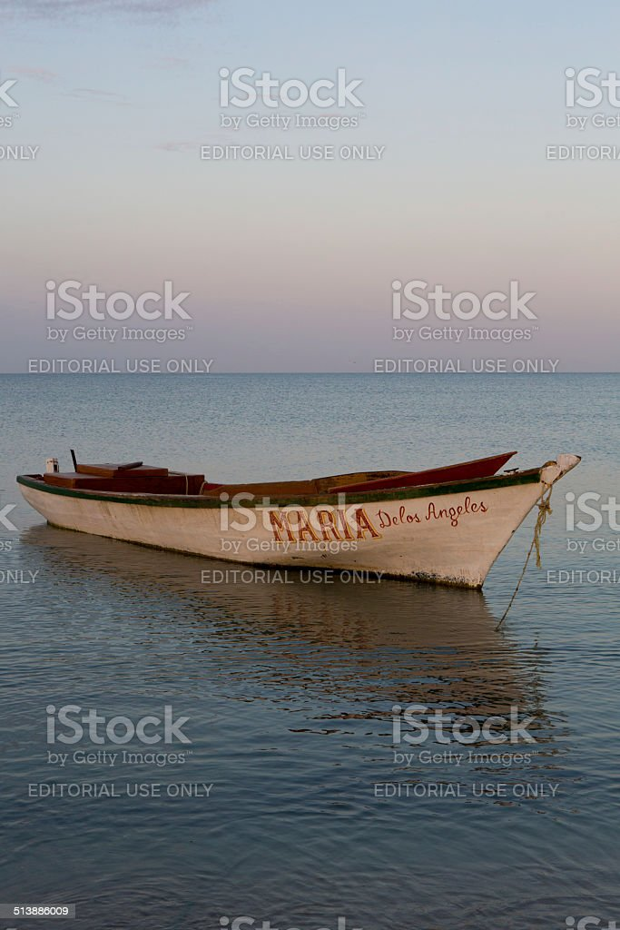Caribbean boat early in the morning on beach stock photo