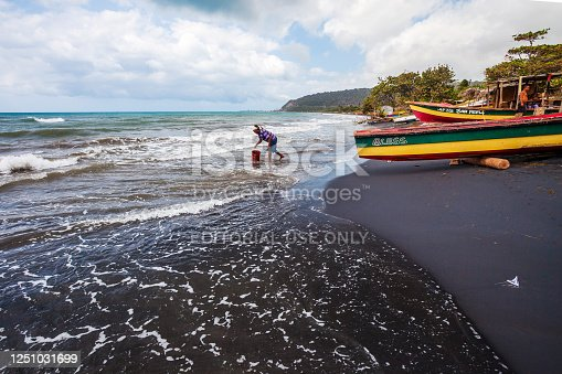 Alligator Pond, Jamaica - Local people standing in coastal waves of small fishing town.
