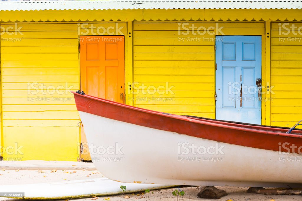 Caribbean colorful house with boat stock photo