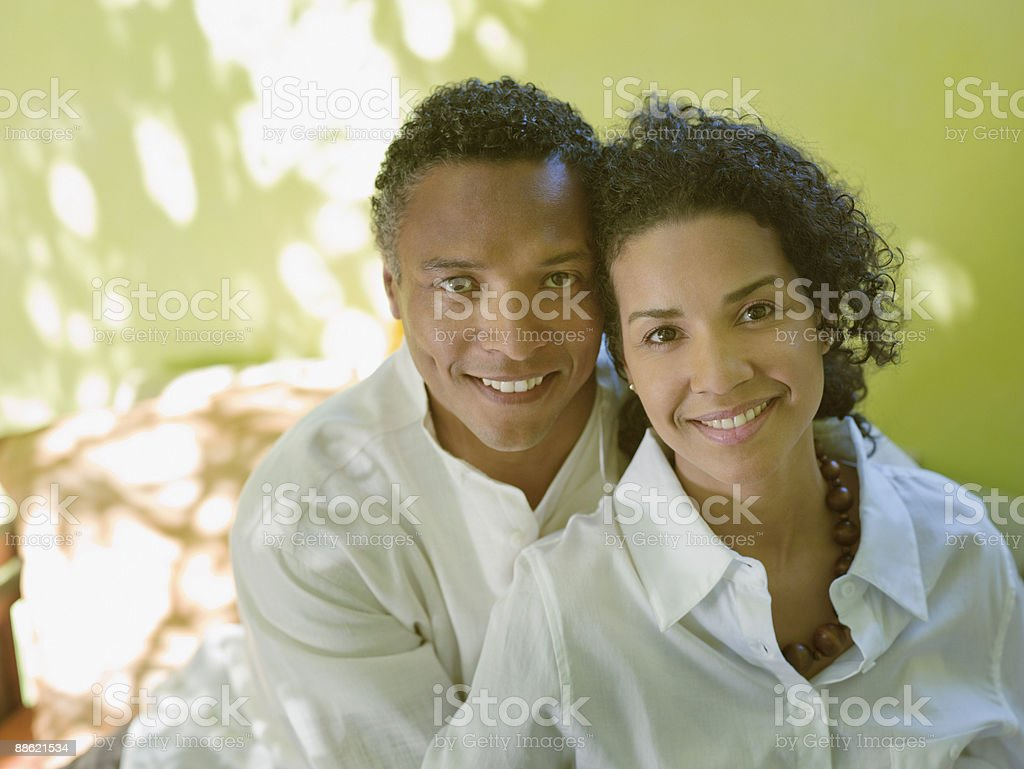 Caribbean couple hugging outdoors royalty-free stock photo