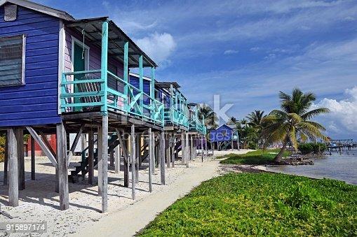 Shot on the Caribbean houses on stilts on the beach.