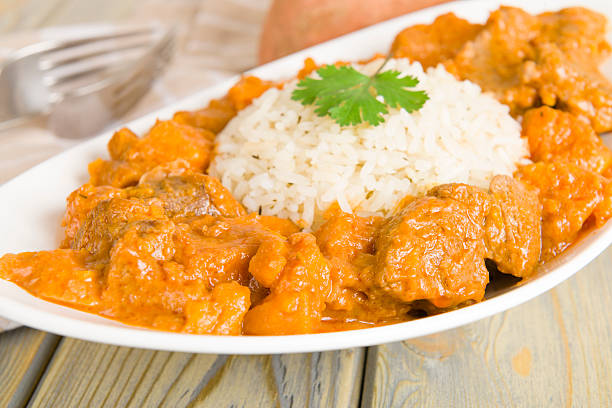caribbean lamb and sweet potato curry - peanut food stock photos and pictures