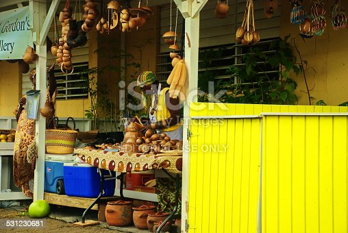 St. Croix, US Virgin Islands-April 20, 2012:  Agricultural market with woman selling coconut products and crafts.