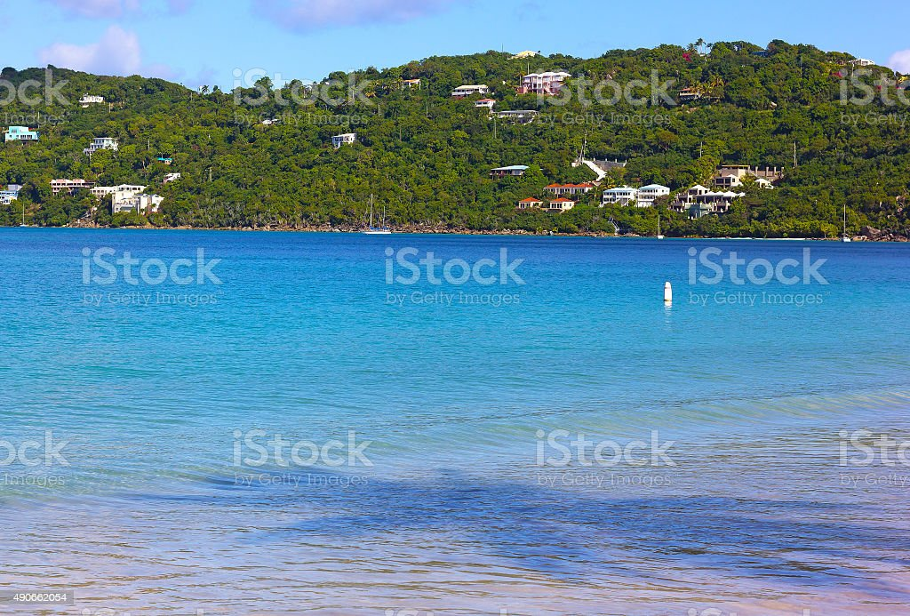 Caribbean Sea in the morning with yachts and palm shadows. stock photo