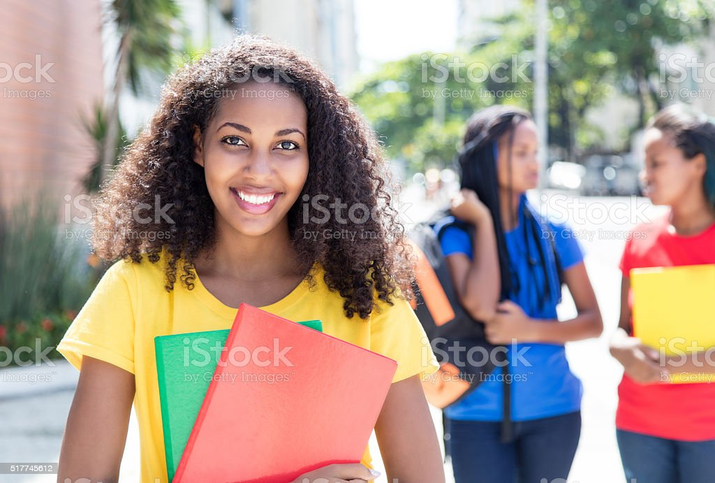 Caribbean student in the city with friends stock photo