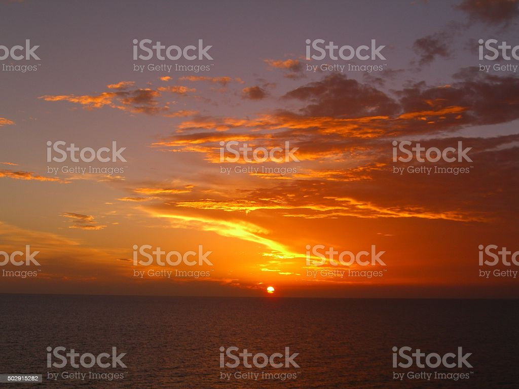 Caribbean Sunset over the Ocean stock photo