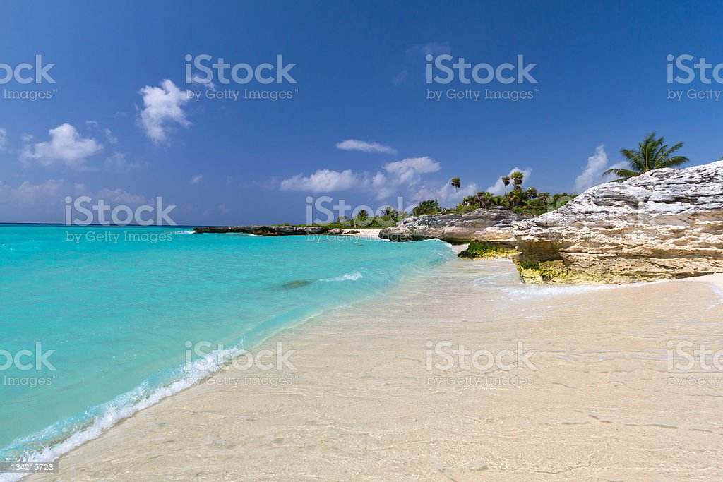 Caribbean waves roll upon sandy Mexican beaches stock photo