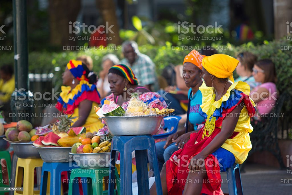 Caribbean women dressed with colors stock photo