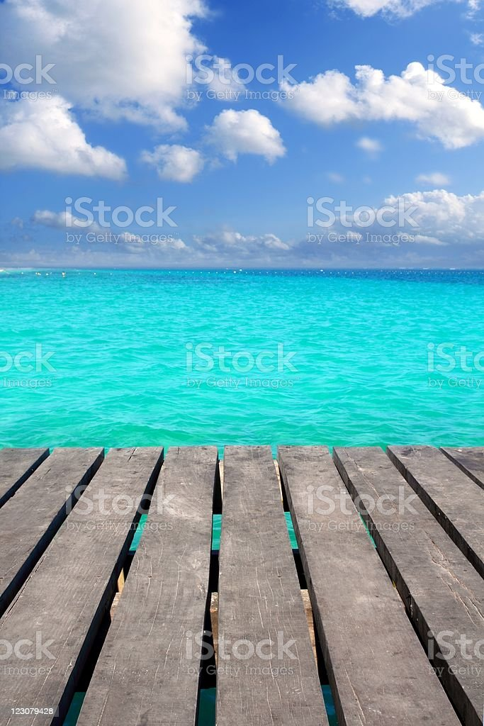 Caribbean wood pier with turquoise aqua sea royalty-free stock photo