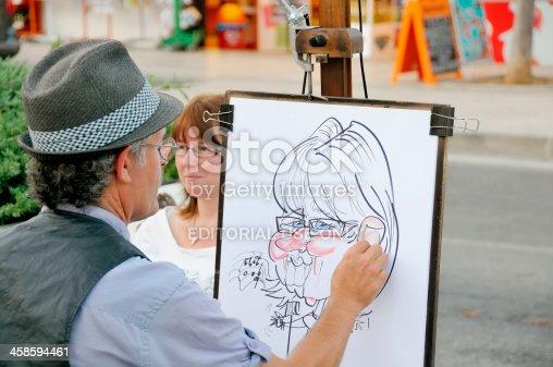 istock Caricature Artist 458594461