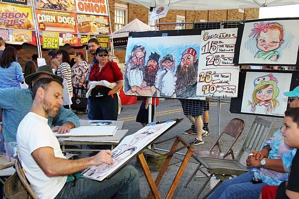 karikatur künstler - karikatur stock-fotos und bilder